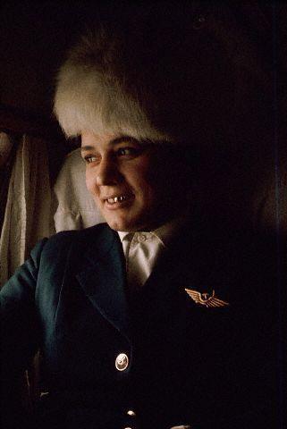 1966, Якустк, Якутия, СССР - Стюардесса Аэрофлота с коронками на зубах, полет из Иркутска в Якутск. Россия. - Дин Конгер.<br />1966, Yakutsk, Yakutia, USSR --- An Aeroflot stewardess with capped teeth during a flight from Irkutsk to Yakutsk. Russia --- Image by © Dean Conger/CORBIS
